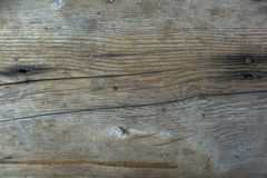 Brown wooden wall with cracks and nail stick. Royalty Free Stock Photo