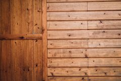 Brown wooden wall and door. texture background. Brown wooden wall and door. abstract texture background Stock Photo