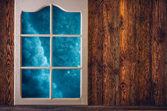 Brown wooden wall and a frosted window Stock Photo