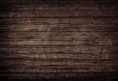 Brown wooden wall, planks, table, floor surface. Dark wood texture. Stock Photos