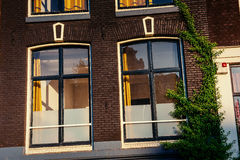 Brown wooden window in brick house. Europe Stock Images