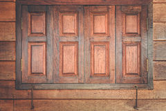 Brown wooden window and wall texture background Royalty Free Stock Photography