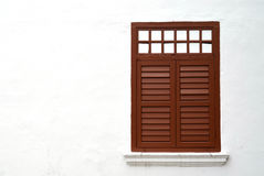 Brown wooden window on white wall with copy space Royalty Free Stock Image