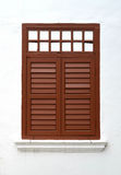 Brown wooden window on white wall Royalty Free Stock Images