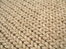 Brown wool background. Brown wool repetitive lines texture royalty free stock photography