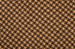 Brown wool houndstooth pattern. Royalty Free Stock Images