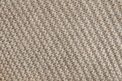 Brown wool knit texture. Knit texture of undyed brown alpaca wool knitted fabric with diagonal garter stitch pattern as background royalty free stock images