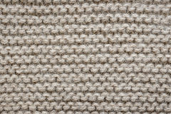 Brown wool knit texture. Knit texture of undyed natural brown alpaca wool knitted fabric with garter stitch pattern as background royalty free stock image