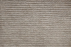 Brown wool knit texture. Knit texture of undyed natural brown wool knitted fabric with garter stitch pattern as background stock photos