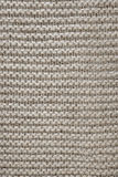 Brown wool knit texture. Knit texture of undyed natural brown wool knitted fabric with garter stitch pattern as background royalty free stock images