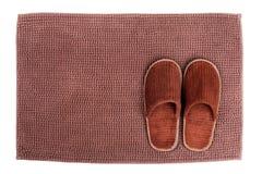 Brown wool slipper on mat Royalty Free Stock Photos