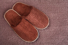 Brown wool slipper on mat Stock Photography