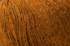 Brown wool thread macro. Texture material blur background royalty free stock images