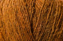 Brown wool thread macro. Texture material blur background stock photography