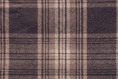 Brown woolen fabric with an checkered pattern Royalty Free Stock Photos