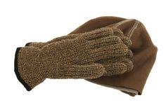 Brown-woolen Schutzkappe und Paare Handschuhe Stockfotos