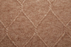 Brown woolen texture. Background rhombus Stock Photo