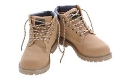 Brown work boots isolated on a white background. Used laces untied Royalty Free Stock Photography
