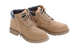 Brown work boots isolated on a white background. Used laces untied Royalty Free Stock Photo