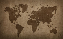Brown world map on old vintage flax linen canvas Stock Photography