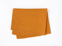 Brown woven cotton placemat. Folded brown cloth place mat Royalty Free Stock Photography
