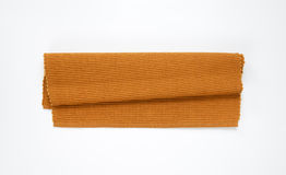 Brown woven cotton placemat. Folded brown cloth place mat Stock Image