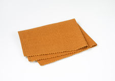Brown woven cotton placemat. Folded brown cloth place mat Royalty Free Stock Photo