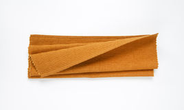 Brown woven cotton placemat. Folded brown cotton place mat Stock Photography
