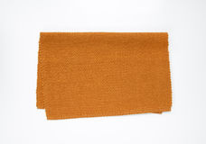 Brown woven cotton placemat. Brown woven cotton place mat folded in half Stock Photo