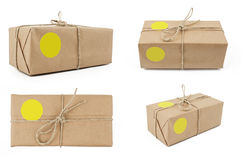 Brown wrapped parcel. With yellow label Stock Photography