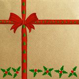 Brown wrapping paper with a red ribbon Royalty Free Stock Photography