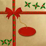 Brown wrapping paper with a red ribbon Stock Photos