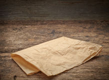 Brown wrapping paper on wooden table Royalty Free Stock Images