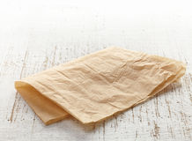 Brown wrapping paper on wooden table Stock Images