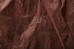 Brown wrinkled packing paper. Background close up view stock photos