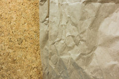 Brown Wrinkled paper on cork board,use as background Royalty Free Stock Photos