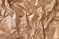 Brown wrinkled plastic texture background. Royalty Free Stock Photo