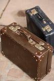 Brown y maletas azules del vintage Imagen de archivo libre de regalías