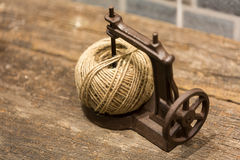 Brown yarn ball in a toy sewing machine Royalty Free Stock Image