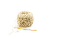 Brown yarn and knitting. Ball of yarn and knitting on white background Royalty Free Stock Photos