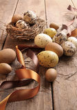 Brown and yellow eggs with ribbons for easter Stock Image