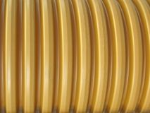 Brown, yellow large plastic rings, cable, Royalty Free Stock Photos