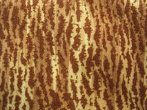 Brown and yellow multicolored fabric background. Brown and yellow varicoloured fabric background Stock Photography