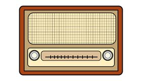 Brown with yellow old retro antique vintage rectangular first hipster radio, music radio receiver with round winders. On a white background Royalty Free Stock Photo