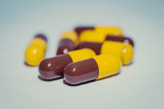 Brown and yellow pills Stock Image