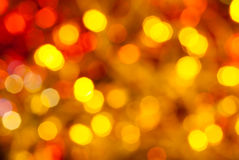 Brown, yellow and red twinkling Christmas lights. Abstract blurred background - brown, yellow and red twinkling Christmas lights of electric garlands on Xmas Stock Images