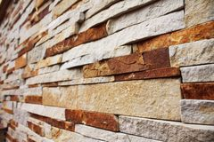 Brown-yellow stacked stone wall Stock Image