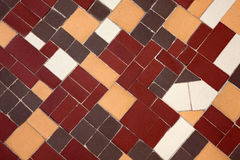 Brown, yellow and white terracotta ceramic tiles. Decorative floor fragment Royalty Free Stock Photos