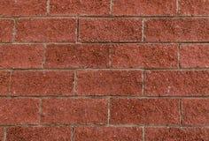 Brown-Ziegelsteinbeschaffenheitsreihe des niedrigen niedrigen Designs der Steine symmetrisch lizenzfreie stockfotografie