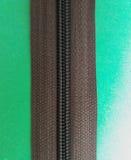 Brown zip or zipper. Brown zipper or zip fastener over green background stock image